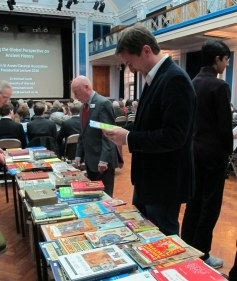 Dr Michael Scott perusing the books before his Presidential Lecture 2016
